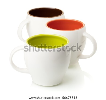 Three color coffee cups, isolated on white background