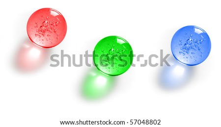 Three color glass balls with bubbles inside - stock photo