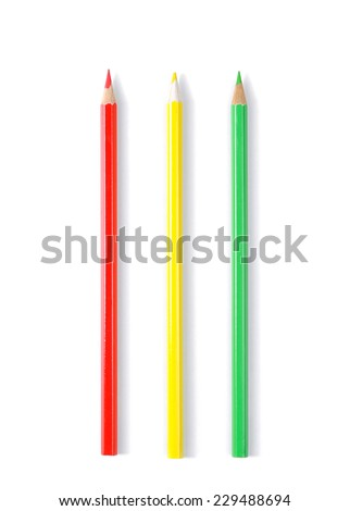 Three color pencils isolated on white