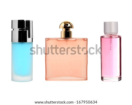 Three color transparent glass perfume bottles isolated on white - stock photo