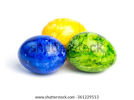 Three colored Easter eggs isolated on white background