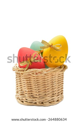 Three colored Easter eggs made of wood on a white background