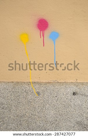 three colored painted spots on a wall