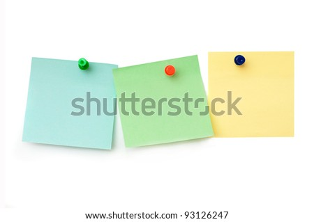 three colored paper stickers on a white background