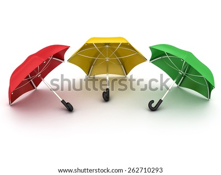 three colored umbrellas on a white background