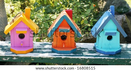 three colorful birdhouses