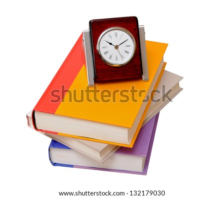 three colorful books and clock isolate on white background