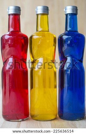 three colorful bottle of drink  - stock photo