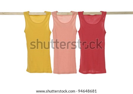 Three colorful clothes on a wooden hanger - stock photo