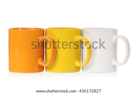 Three colorful cups for tea or coffee, isolated on white background