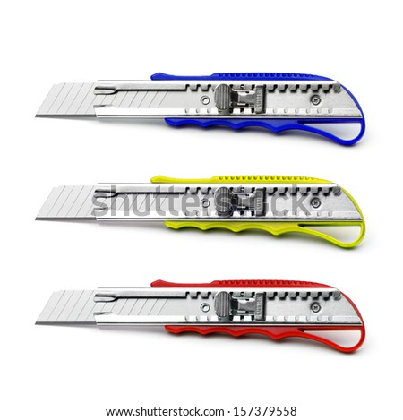 Three colorful cutter isolated isolated on white. - stock photo