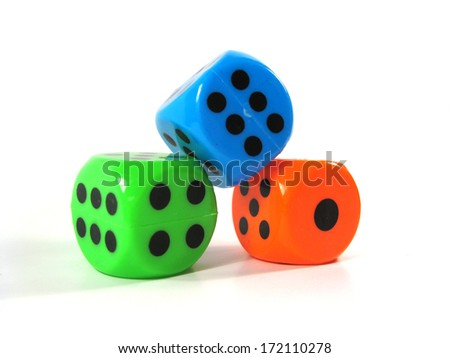 Three colorful dices on the white background.