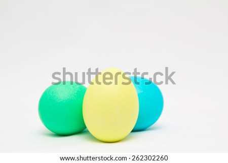 Three colorful easter eggs on light background - stock photo