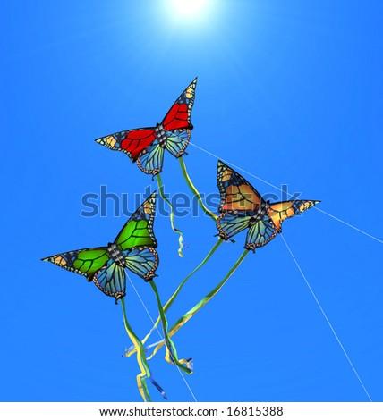 Three colorful kites at sunny sky - stock photo