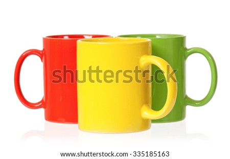 three colorful mugs for coffee or tea isolated on white background - Colorful Mugs
