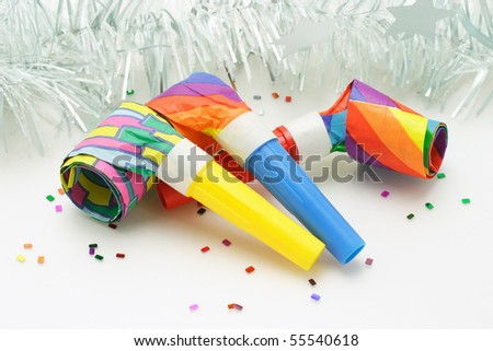 Three colorful paper party blowers - stock photo