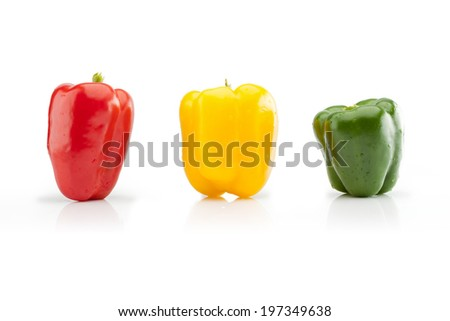 Three colorful pepper on white background