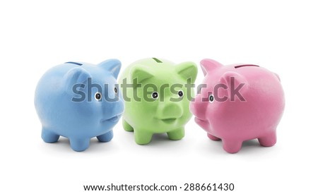 Three colorful piggy banks  - stock photo