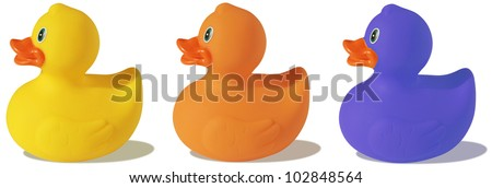 Three colorful plastic ducks - stock photo