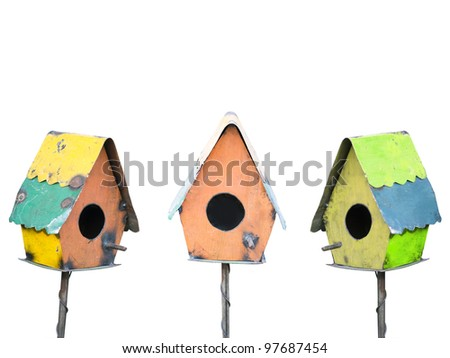 Three colorful rustic birdhouses isolated on white - stock photo