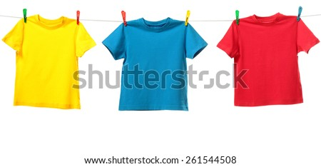 Three colorful shirts hanging on the clothesline. Image isolated on white background   - stock photo