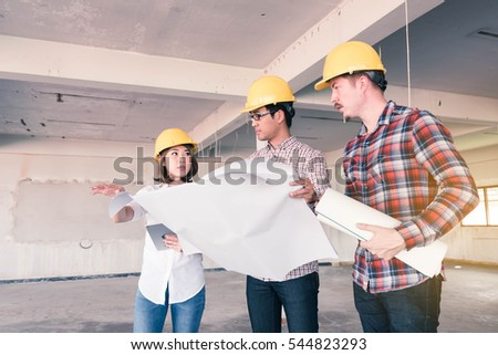 three construction engineers working together in side building planning for the renovation