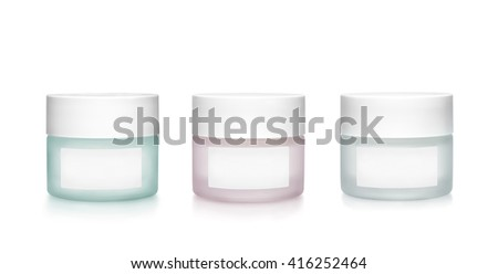 Three cosmetic containers of frosting glass. Green, pink and  grey color isolated on white background. Clipping path on containers and tags.