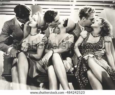 Three couples kissing