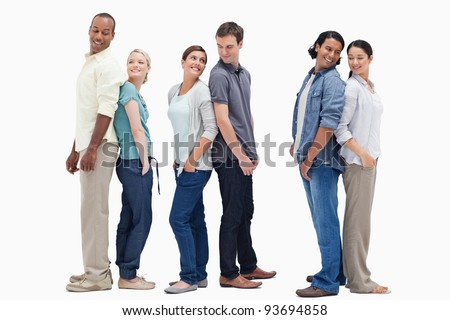 Three couples standing back to back looking at each other against white background - stock photo