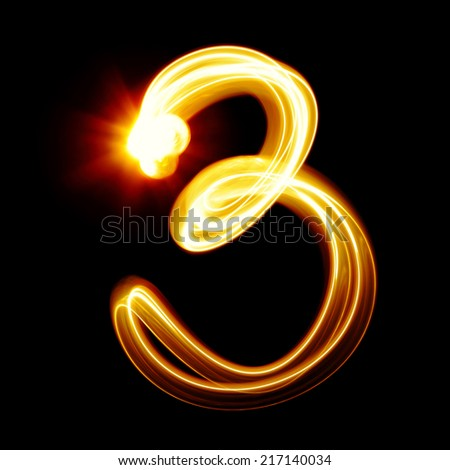 Three - Created by light numerals over black background - stock photo