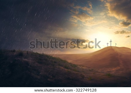 Three crosses in the distance in the desert - stock photo