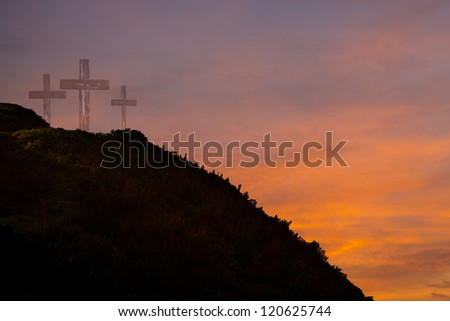 Three crosses on a hill at sunrise - stock photo