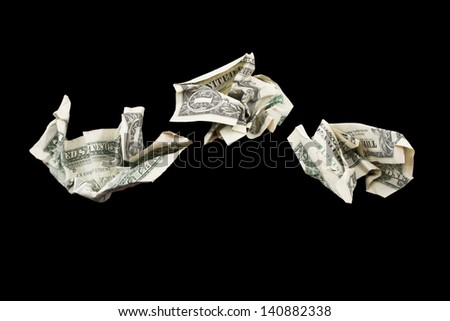 Three crumpled one dollar bills isolated on black Background. - stock photo
