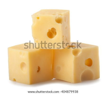 three cubes of cheese with big holes isolated on white background. Heap of maasdam pieces