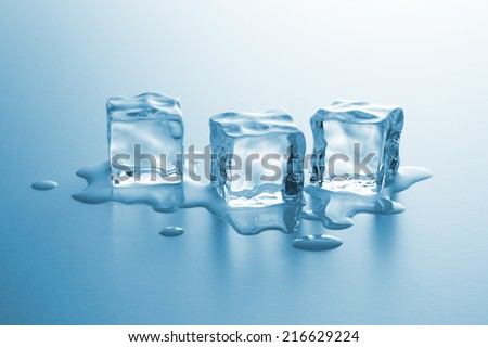 Three cubes of frozen ice are melting
