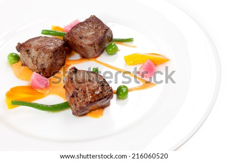 three cubes of meat in the oven - stock photo