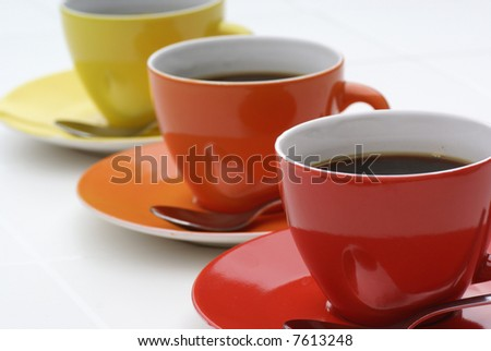 Three cups of coffe in diagonal line.