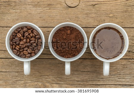 Three cups of different stages of preparing coffee - stock photo