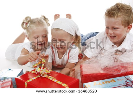 three cute children celebrating special occasion with several gifts