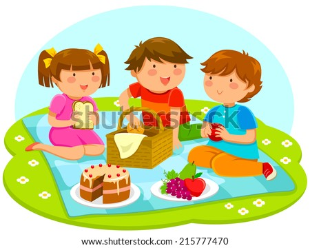 three cute kids having a picnic together - stock photo
