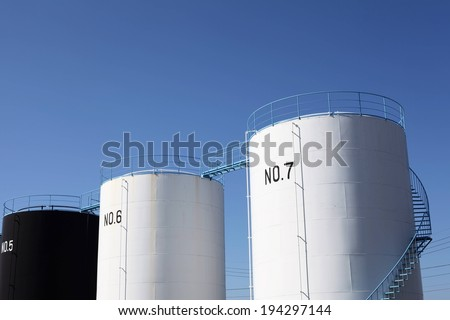 Three cylinder shaped units marked with numbers five, six and seven. - stock photo