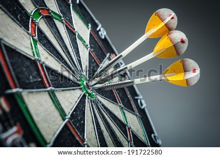 Three darts in the target center - stock photo