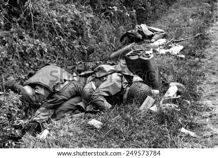 Three dead U.S. Airborne troops in a ditch near Sainte-Marie-du-Mont, Normandy, June 7, 1944. Other D-Day invasion paratroopers captured the town. France, World War 2.
