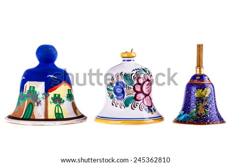 three decorated ceramic bells isolated over a white background - stock photo