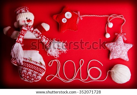 Three decorative stars, funny snowman and white ball of yarn on hot red background. Christmas and New Year theme. Place for your text, wishes, logo. - stock photo