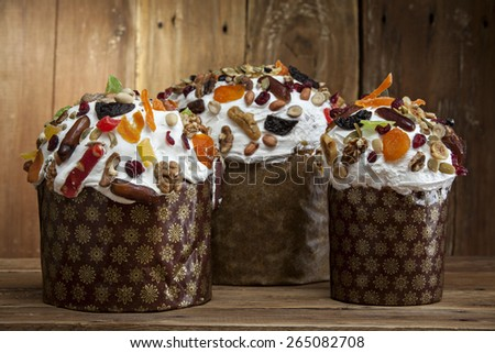 Three delicious freshly baked Easter cakes on a wooden background - stock photo