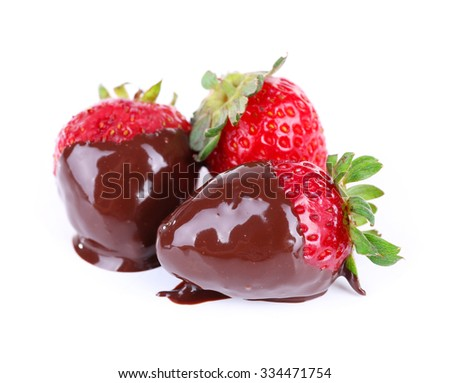 Three delicious strawberries dipped in chocolate isolated on white - stock photo