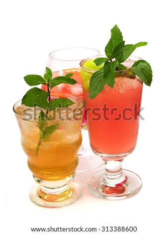 Three deliscious cocktails isolated on white background - Canadian cocktail, Negroni (Itailian) and Mai Tai (Tahitian) - stock photo