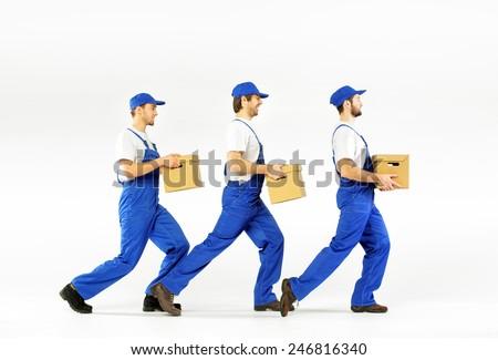 Three delivery men - stock photo