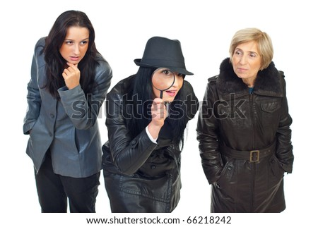 Three detectives women at work ,one of them looking through magnifying glass and being surprised